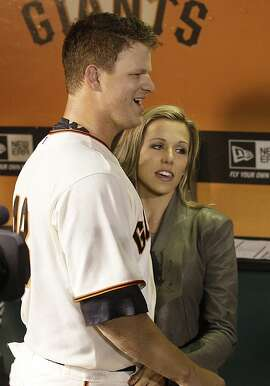 San Francisco Giants pitcher Matt Cain, left, celebrates with his wife Chelsea after a baseball game against the Houston Astros in San Francisco, Wednesday, June 13, 2012. Cain pitched the 22nd perfect game in major league history and first for the Giants, striking out a career-high 14 and getting help from two spectacular catches to beat the Houston Astros 10-0. (AP Photo/Jeff Chiu)