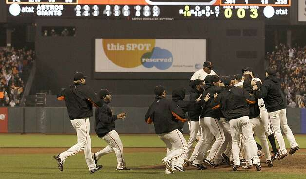 San Francisco Giants players celebrate after pitcher Matt Cain pitched a perfect game in a baseball game against the Houston Astros in San Francisco, Wednesday, June 13, 2012. Cain pitched the 22nd perfect game in major league history and first for the Giants, striking out a career-high 14 and getting help from two spectacular catches to beat the Houston Astros 10-0. Photo: Jeff Chiu, Associated Press