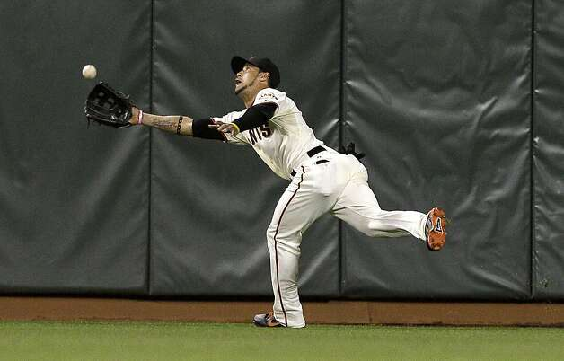 Right fielder Gregor Blanco ran a long way before diving to catch Jordan Schafer's drive to right-center in the seventh, landing with a belly flop on the warning track. Photo: Jeff Chiu, Associated Press