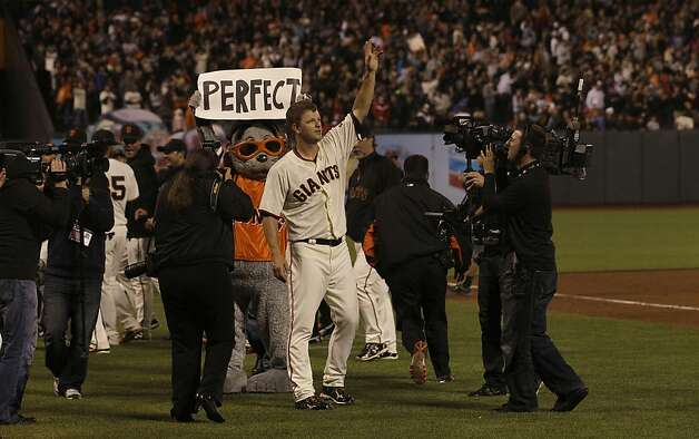 San Francisco Giants pitcher Matt Cain celebrates after the final out of the ninth inning of a baseball game against the Houston Astros in San Francisco, Wednesday, June 13, 2012. Cain pitched a perfect game. The Giants won 10-0. (AP Photo/Jeff Chiu) Photo: Jeff Chiu, Associated Press