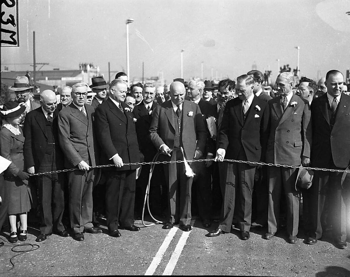 Gove. Frank F. Merriam, former President Herbert Hoover and others were among the group that cut a golden chain to celebrate the opening of the Bay Bridge. Nov. 11, 1936