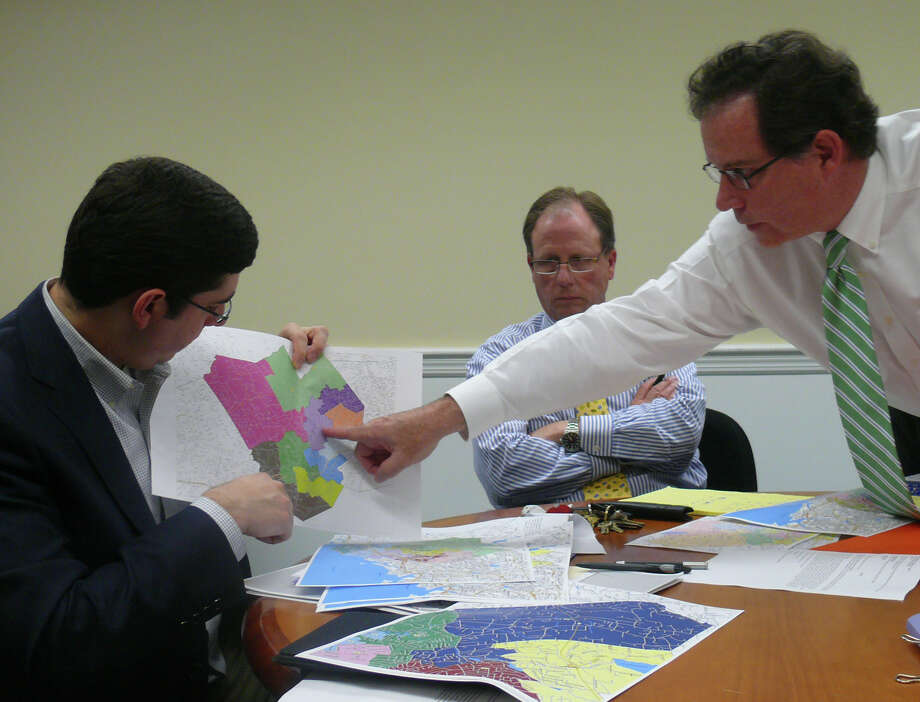 Members of the Representative Town Meeting Redistricting Subcommittee, from left, David Becker, R-1; John Mitola, D-2, and Kevin Hoffkins, D-7, look at a map of RTM districts at a Wednesday meeting. Photo: Genevieve Reilly / Fairfield Citizen