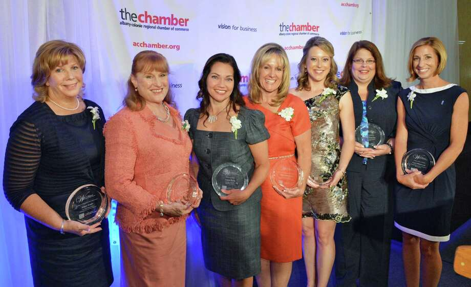 Recipients of the 21st annual Albany-Colonie Chamber's Women of Excellence awards are , from left, Joanne Kugler, CEO for GE Energy Power and Water Business, Dr. Susan Scrimshaw, president of The Sage Colleges, Lauren Payne of Spiral Design Studio, Susan Commanda, CEO of Hudson River Community Credit Union, Sara Brenner, MD, MPH, assist. vice president for NanoHealth Initiatives, Milinda J. Reed, Esq., director, domestic violence services for Unity House and Carrie Hillenbrandt, corp. director of sales and marketing at BBL Hospitality at the Chamber luncheon in Colonie Wednesday June 13, 2012.   (John Carl D'Annibale / Times Union) Photo: John Carl D'Annibale / 00017489A