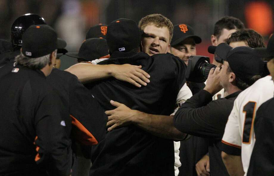 San Francisco Giants pitcher Matt Cain, facing, celebrates with teammates after pitching a perfect game in a baseball game against the Houston Astros in San Francisco, Wednesday, June 13, 2012. The Giants won 10-0. (AP Photo/Jeff Chiu) Photo: Jeff Chiu, Associated Press / AP