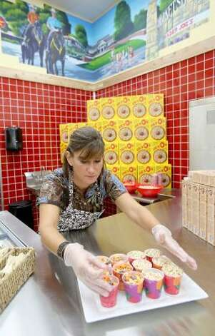 Molly Meyer prepares samples at the first Trader Joe's in Houston, which opens Friday, June 15, 2012, at the Woodlands Crossing Shopping Center in The Woodlands. (Thomas B. Shea / For the Chronicle)