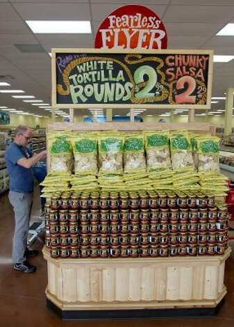 Scott Pierce stocks shelves at the first Trader Joe's in Houston, which opens Friday, June 15, 2012, at the Woodlands Crossing Shopping Center in The Woodlands. (Thomas B. Shea / For the Chronicle)