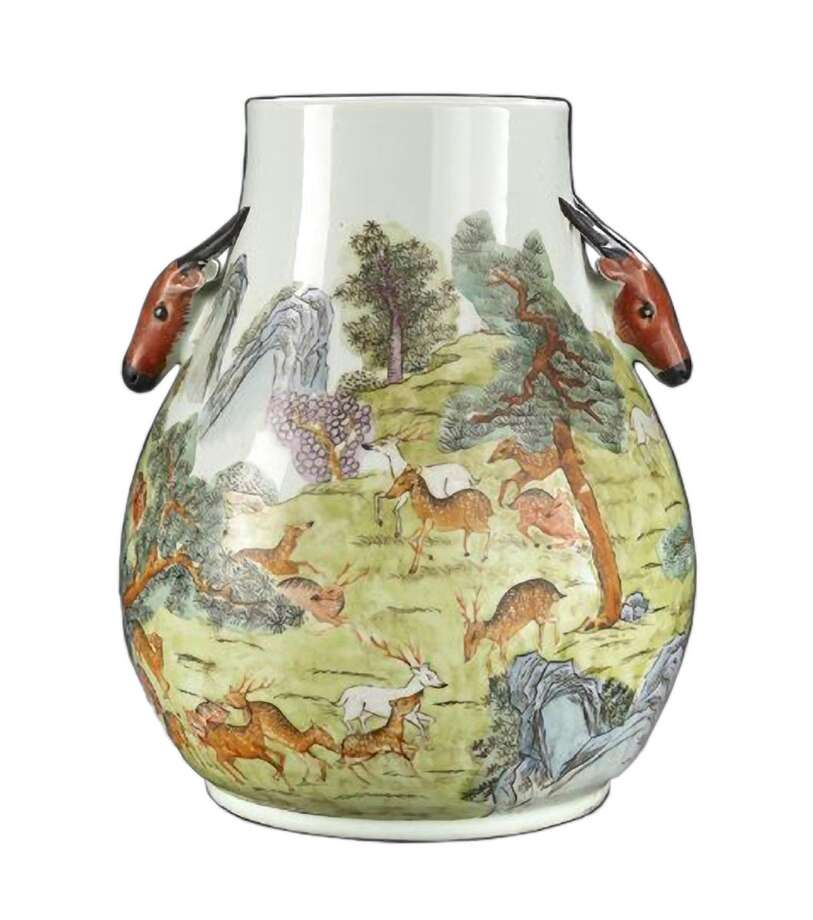 This famille rose ìHundred Deerî vase was made in the 20th century but appears to be older. It is worth close to $2,000. The deer represented by the antlered deer-head handles and in the decorative scene are from a breed native to China. They look very different from deer native to the United States.  Photo credit: New Orleans Auction Galleries. Photo: Contributed Photo