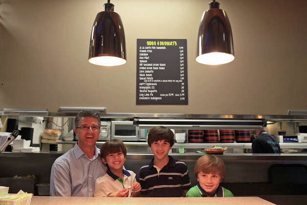 Barclay Anthony stands with his sons, Beau, 5 (from left), Luke, 10, and Wyatt, 8, at their family's restaurant, Sea Island Shrimp House. Photo: Lisa Krantz, San Antonio Express-News / 2012 San Antonio Express-News