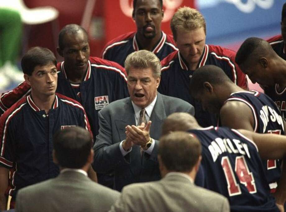 FILE - In this July 27, 1992, file photo, U.S. men's basketball coach Chuck Daly talks with the team during a preliminary-round basketball game with Croatia at the Summer Olympics in Barcelona, Spain. Daly, who coached the Dream Team to the Olympic gold medal in 1992 after winning back-to-back NBA championships with the Detroit Pistons, died Saturday, May 9, 2009, in Jupiter, Fla. He was 78. (AP Photo/Ed Reinke, File) (AP)