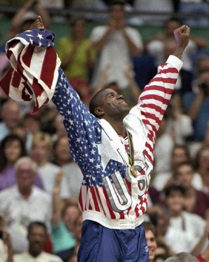 "FILE - In this Aug. 8, 1992, file photo, USA's Earvin ""Magic"" Johnson rejoices with his gold medal after beating Croatia 117-85 in the gold medal game in men's basketball at the Summer Olympics in Barcelona. It's not an urban legend: The Dream Team really did lose a scrimmage to a group of college stars as the future Hall of Famers prepared for the 1992 Olympics. Footage of that game is among the new behind-the-scenes material in the 20-year anniversary documentary that premieres on NBA TV on Wednesday. (AP Photo/Susan Ragan, File) (AP)"