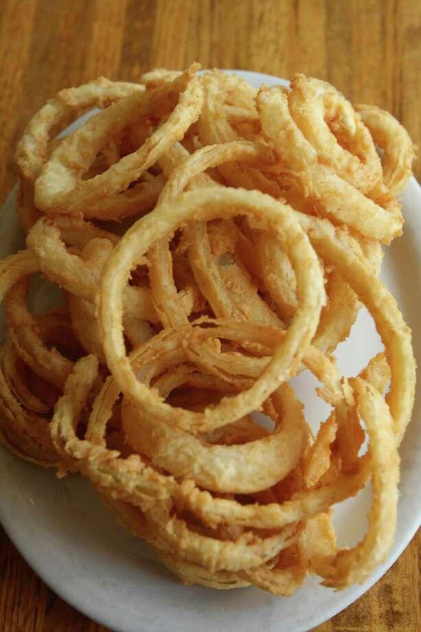 ... a 1.5-ounce serving of Burger King Onion Rings (151 calories). Photo: Julysa Sosa, San Antonio Express-News / SAN ANTONIO EXPRESS-NEWS
