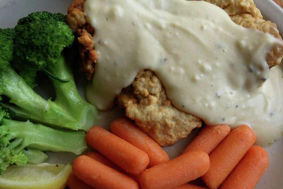 Good Time Charlie's chicken fried steak Monday June 11, 2012. Photo: Julysa Sosa, San Antonio Express-News / SAN ANTONIO EXPRESS-NEWS