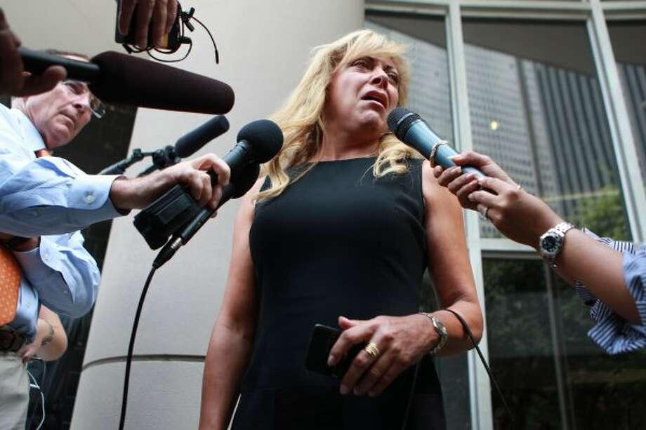 "Martha Blanchet of Miami, Fla., says R. Allen Stanford, ""deserves death."" Blanchet lost her savings in the Stanford Ponzi scheme. ( Johnny Hanson / Houston Chronicle )"