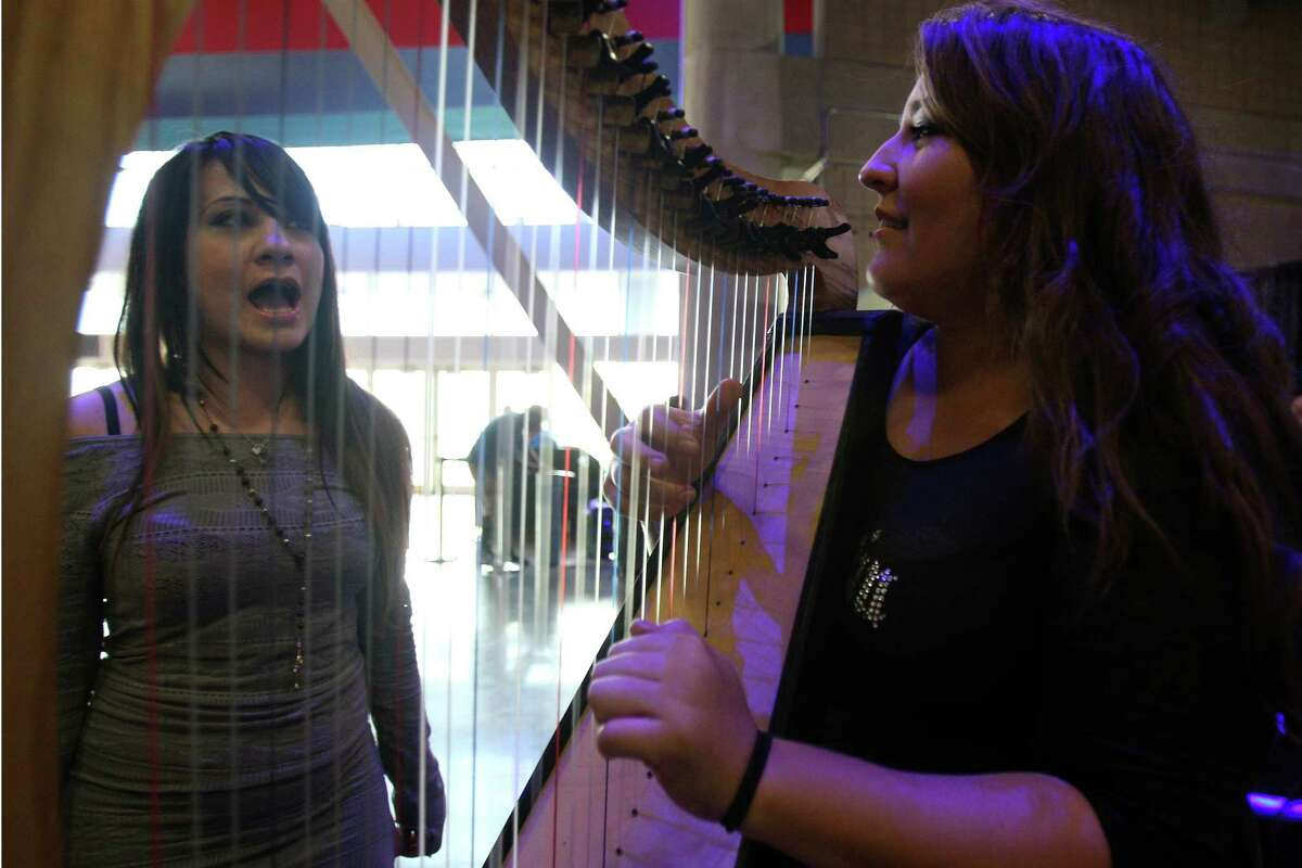 """(From left) Chloe Loverock sings """"Rolling in the Deep"""" by Adele while Kristen Smith plays the harp during the American Idol auditions Thursday June 14, 2012 at the Alamodome."""