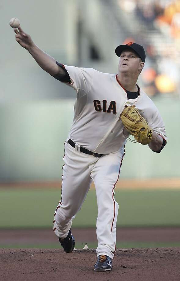 San Francisco Giants pitcher Matt Cain delivers against the Houston Astros during the first inning of a baseball game in San Francisco, Wednesday, June 13, 2012. Cain pitched a perfect game. The Giants won 10-0.  (AP Photo/Jeff Chiu) Photo: Jeff Chiu, Associated Press