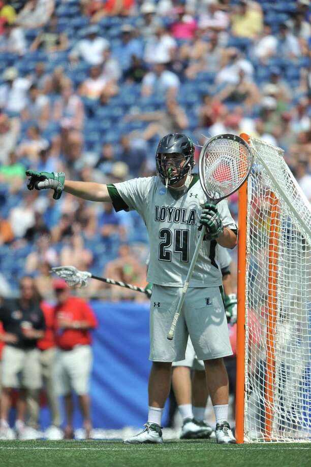 Fairfielder Jack Runkel-- pictured in the Division I men's lacrosse national championship game against the University of Maryland in Foxborough, Mass.-- led Loyola University (Md.) to its first lacrosse national championship in 2012. Photo: Contributed Photo/Larry French, Contributed Photo / Fairfield Citizen contributed