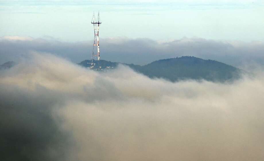 Sutro Tower rises above a break in the clouds in San Francisco, Calif., after a night of rain throughout the Bay Area on Wednesday, June 3, 2009. Photo: Paul Chinn, The Chronicle