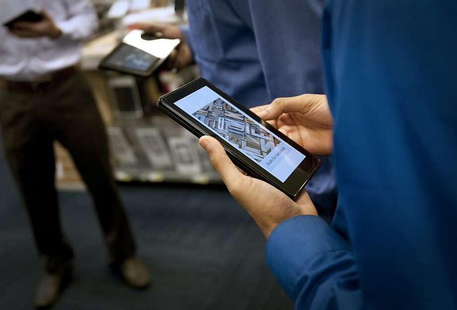 Best Buy Co. employees are instructed on how to use the Amazon.com Inc. Kindle Fire tablet computer at a store in New York, U.S., on Tuesday, Nov. 15, 2011. Amazon.com Inc., the world's largest Internet retailer, and Discovery Communications Inc. settled their patent disputes over book readers and Internet shopping, according to court documents. Photographer: Scott Eells/Bloomberg Photo: Scott Eells, Bloomberg