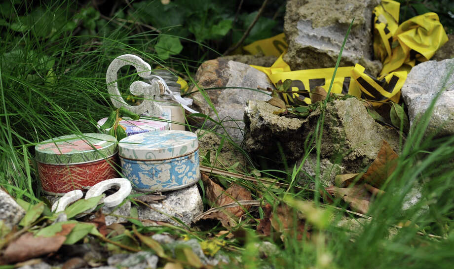 Candles and wooden letters sit beside crime scene tape in front of 2267 Shippan Ave where a fire in the Badger family home on Christmas morning, 2011, killed three children and their grandparents. Photo: Lindsay Niegelberg / Stamford Advocate