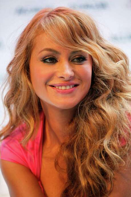 FILE - In this May 18, 2011 photo, Mexico's pop star Paulina Rubio smiles during a news conference in Mexico City. Rubio, who is being sued by Miami-based CMG Entertainment over her failure to show up at a concert in Tunja, Colombia, has asked a judge to bar the media from attending a deposition by her manager scheduled for Thursday, June 9, 2011. Photo: AP
