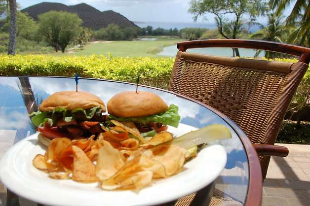 Cafe on the Green, the Makena Beach and Golf Resort's hilltop restaurant, offers views of the links, the Puʻu Olaʻi cinder cone and the ocean along with fresh, locally sourced menu items, including breads made in house and produce grown at the resort. Photo: Jeanne Cooper, Special To SFGate