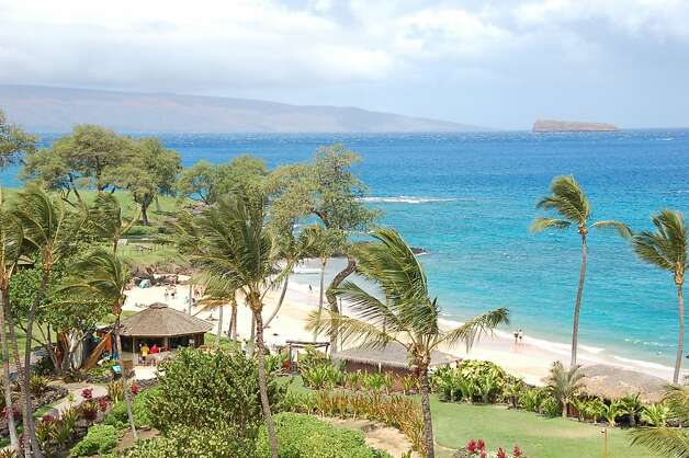 "Maluaka Beach, seen with the snorkeling destination of Molokini in the distance, puts the ""beach"" in Makena Beach and Golf Resort. There is public access and a small park on the north end, but the beach lies fully within the 1,800-acre resort. Photo: Jeanne Cooper, Special To SFGate"