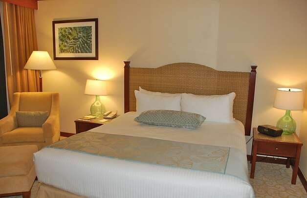 Renovations of the 310 rooms and suites at the Makena Beach and Golf Resort, formerly the Maui Prince, include new Serta Presidential beds and linens, carpeting, cherry wood furnishings, 37-inch flat-screen TVs and modern Hawaiian artwork. Rooms start at about 500 square feet, including large balconies  with lounge chairs, plus hallways by the entrances and the bathrooms, remodeled with granite countertops and other new fixtures. Photo: Jeanne Cooper, Special To SFGate