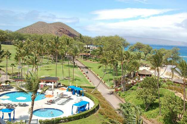 The swimming pool and children's pool at Makena Beach and Golf Resort are not particularly large, but Maluaka Beach is just a few steps away, and the cinder cone of Pu'u Ola'i points the way to the even longer beach at Makena State Park. Photo: Jeanne Cooper, Special To SFGate