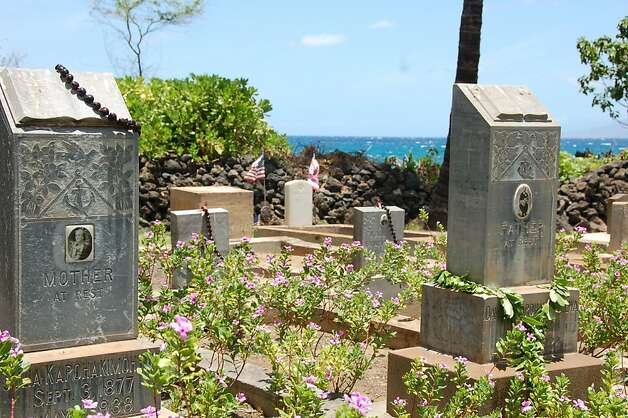 One of the most scenic spots for a final resting place, the cemetery at Makena's seaside Keawala'i Congregational Church   shows a blend of Hawaiian and Western customs, with kukui nut leis and tropical flowers decorating headstones, most of which bear names of Hawaiian families from the area. Visitors are welcome, as long as they treat gravesites with respect and also don't use the church's tiny parking area for overflow beach parking. Photo: Jeanne Cooper, Special To SFGate