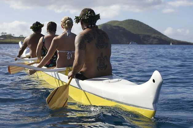 The beach boys who lead Makena Beach and Golf Resort's outrigger canoe ride in Makena Bay share the area's rich history as well as Hawaiian paddling traditions with participants. Photo: Makena Beach And Golf Resort