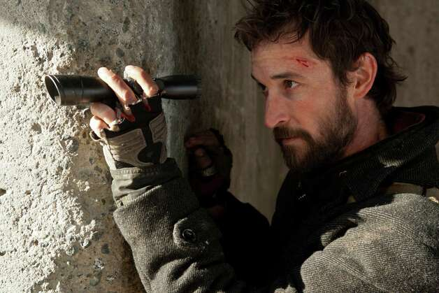 "Noah Wyle plays the head of a resistance team fighting alien invaders in ""Falling Skies,"" which returns for a second season. Photo: James Dittiger, TNT"