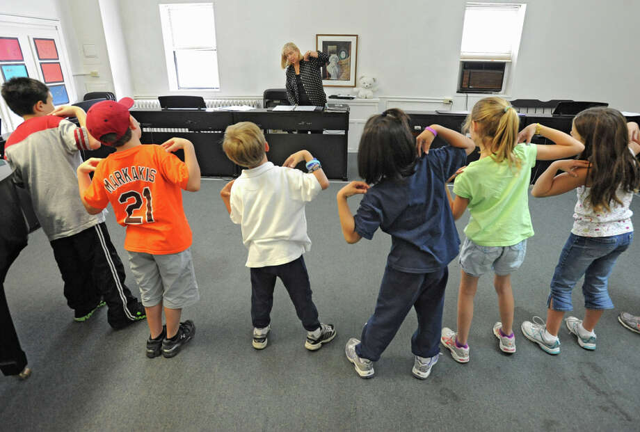 Noel Liberty teaches music lessons to students at The Music Studio June 6, 2012 in Colonie, N.Y. The children are preparing for the 35th anniversary concert of The Music Studio school. (Lori Van Buren / Times Union) Photo: Lori Van Buren