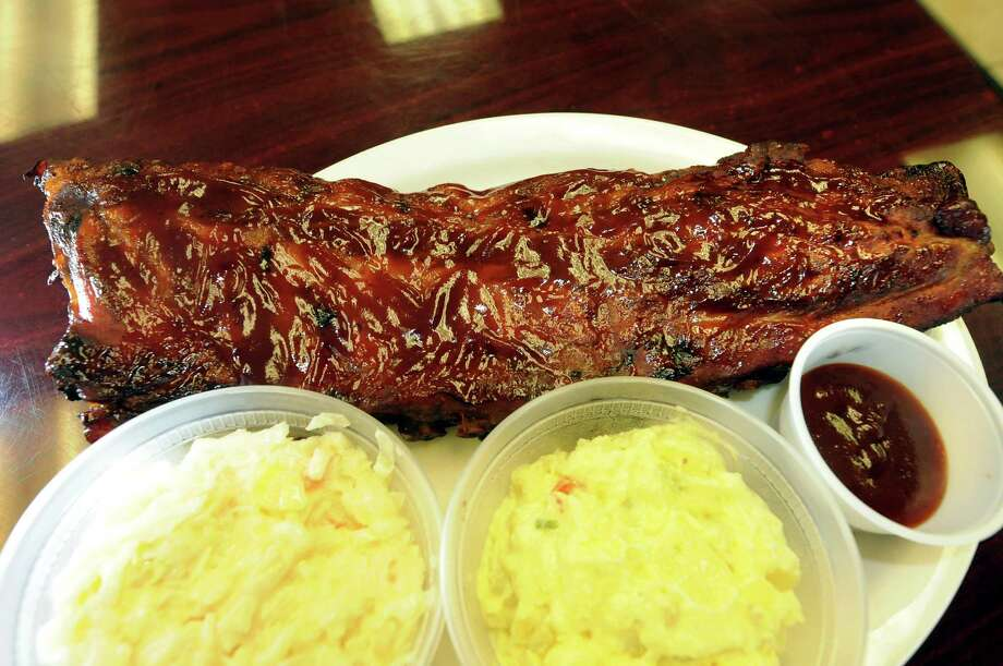 Smoked BBQ plate with full rack of ribs and coleslaw and potato salad on Tuesday, June 12, 2012, at Mustang BBQ in Lansingburgh, N.Y. (Cindy Schultz / Times Union) Photo: Cindy Schultz / 00018044A
