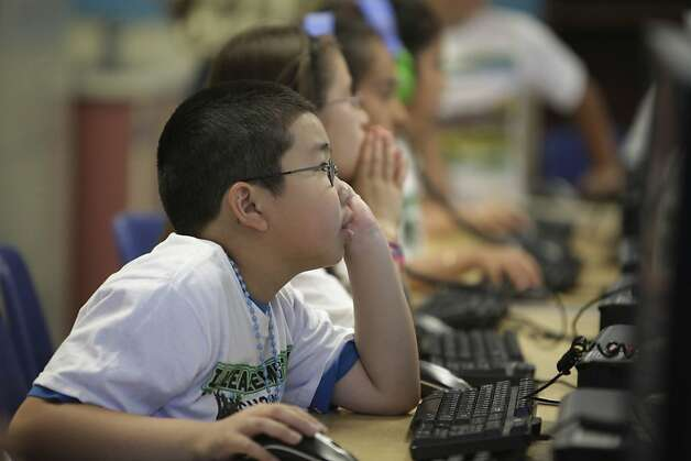 Lazear Elementary School fourth grader David Nguyen works on his reading test on Wednesday, June 13, 2012 in Oakland, Calif. Photo: Lea Suzuki, The Chronicle