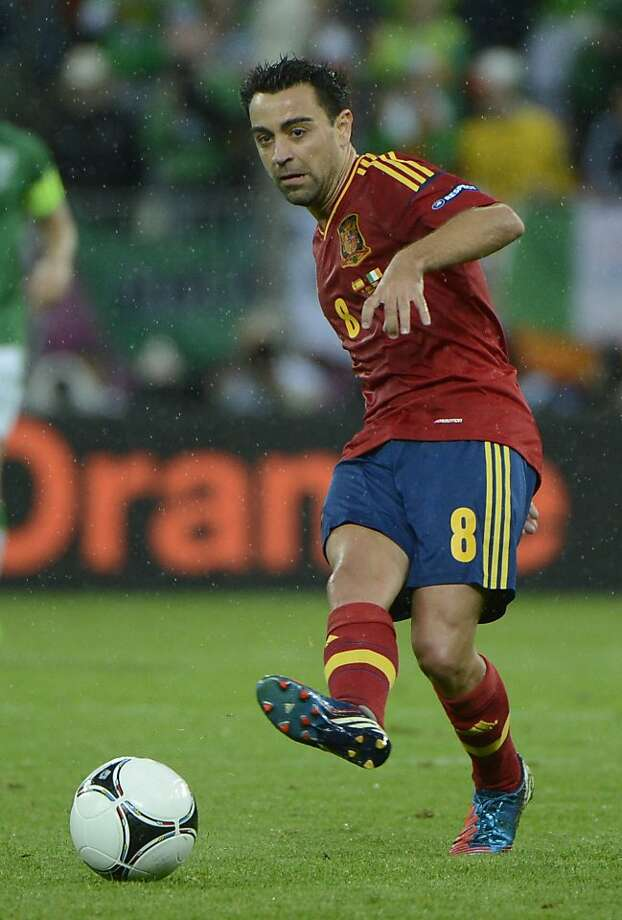 Spanish midfielder Xavi Hernandez passes the ball during the Euro 2012 championships football match Spain vs Republic of Ireland on June 14, 2012 at the Gdansk Arena.    AFP PHOTO / PIERRE-PHILIPPE MARCOUPIERRE-PHILIPPE MARCOU/AFP/GettyImages Photo: Pierre-philippe Marcou, AFP/Getty Images