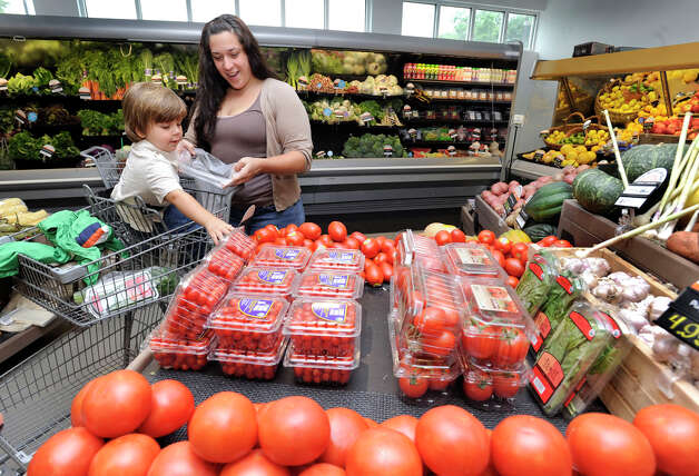 Michele DePietro, 32, of Waterbury, shops with her son Gabriel, 1 1/2, at New Morning, a natural health food store in Woodbury, Wednesday, June 13, 2012. Photo: Carol Kaliff