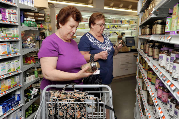 Belmira Velente, left, 65, and Maria D'Oliveira, 66, both of Naugatuck, shop for vitimins at New Morning, a natural health food store in Woodbury, Wednesday, June 13, 2012. Photo: Carol Kaliff