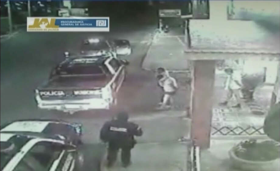 In this frame grab taken from video filmed by a surveillance camera on Jan 20, 2012, and released by the Jalisco state prosecutors' office on June 14, 2012, three men walk away from a hotel in their underwear with their hands tied behind their backs and some blindfolded, as they are led by men dressed in police uniforms toward police vehicles in Lagos de Moreno, Mexico. The men later were found asphyxiated and beaten to death. Jalisco prosecutors' spokesman Lino Gonzalez said Thursday June 14, 2012 that the five officers, their commander and the local police chief in Lagos de Moreno have been detained pending charges. Photo: AP