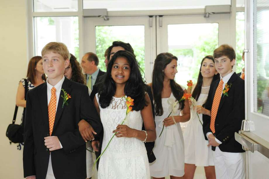 Eric Gourdon and Sadhana Paresh Shah begin the procession during the Greenwich Country Day School's 85th commencement Thursday, June 14, 2012. Photo: Helen Neafsey / Greenwich Time