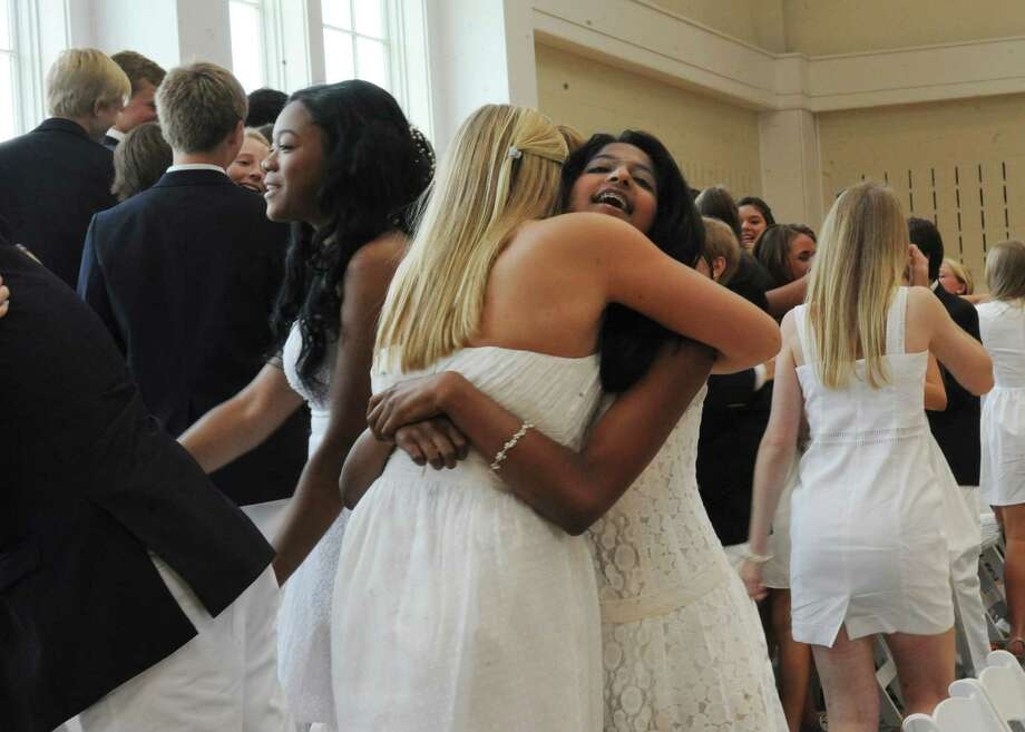 Sadhana Paresh Shah hugs a graduate during Greenwich Country Day School's 85th commencement Thursday, June 14, 2012. Photo: Helen Neafsey / Greenwich Time