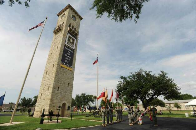 The clock tower bears a banner announcing the Army's 237th birthday during a celebration at the Fort Sam Houston Quadrangle on Thursday, June 14, 2012. Photo: Billy Calzada, San Antonio Express-News / © 2012 San Antonio Express-News