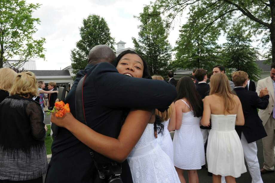 Abygail Meeks hugs math teacher Rod Fludd after the Greenwich Country Day School's 85th commencement Thursday, June 14, 2012. Photo: Helen Neafsey / Greenwich Time