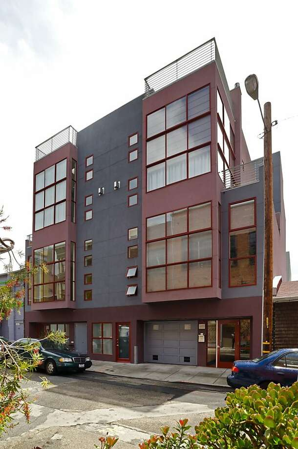 A grey and red exterior facade with a cubed, bay-window effect offers disciplined symmetry in this Minna Street structure, complementing the 21st-century industry to which it it lies adjacent. Photo: Jim Filo, Reflex Imaging