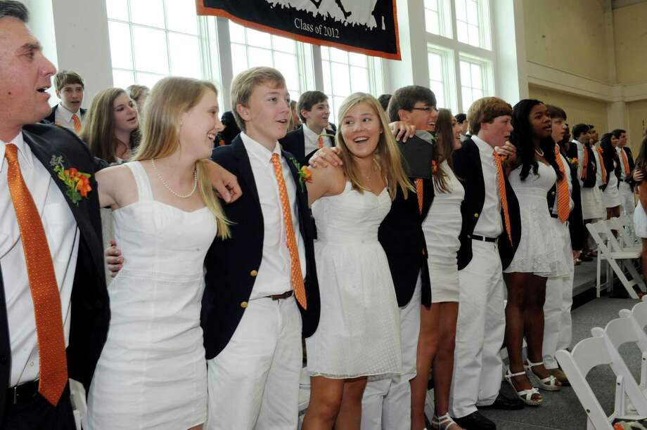 Phebe Huth, center, sings the School Song with other graduates at Greenwich Country Day School's 85th commencement Tuesday, June 14, 2012. Photo: Helen Neafsey / Greenwich Time