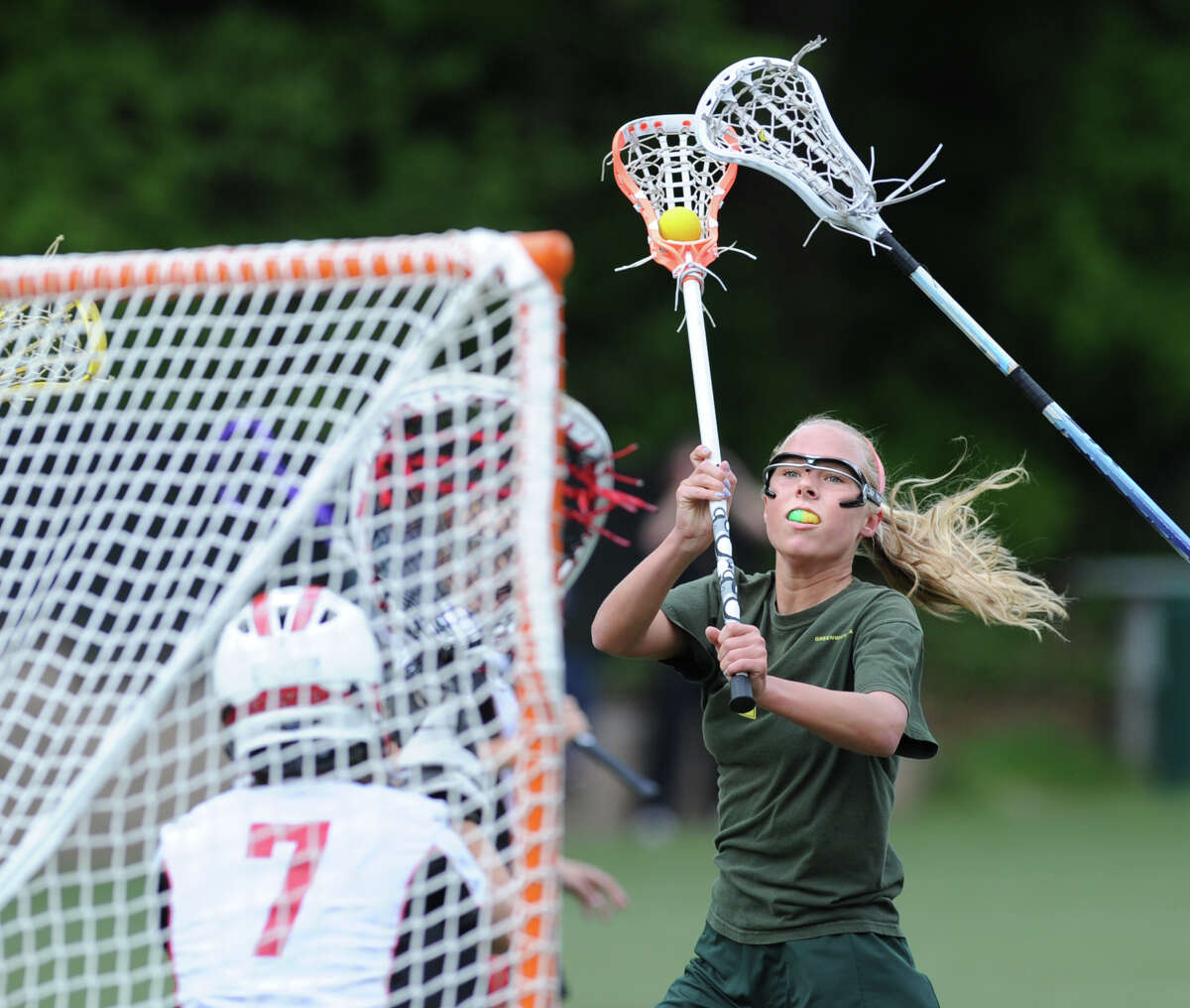 Emily Conway of Greenwich Academy attempts to line up a shot during girls high school lacrosse match between Rye High School and Greenwich Academy at Greenwich Academy, Saturday afternoon, May 5, 2012. Conway missed on her shot attempt as Rye went on to defeat GA, 12-11.