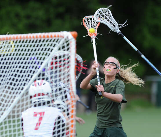 Emily Conway of Greenwich Academy attempts to line up a shot during girls high school lacrosse match between Rye High School and Greenwich Academy at Greenwich Academy, Saturday afternoon, May 5, 2012. Conway missed on her shot attempt as Rye went on to defeat GA, 12-11. Photo: Bob Luckey / Greenwich Time