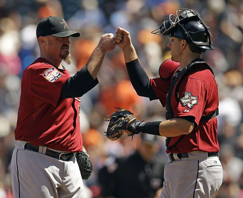 Houston Astros relief pitcher Brett Myers, left, and catcher Jason Castro celebrate a 6-3 win over the San Francisco Giants after a baseball game in San Francisco, Thursday, June 14, 2012. (AP Photo/Marcio Jose Sanchez) Photo: Marcio Jose Sanchez, Associated Press