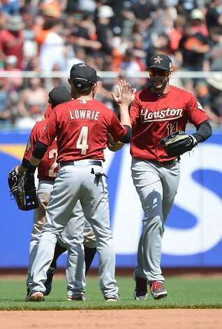 SAN FRANCISCO, CA - JUNE 14:  J.D. Martinez #14 and Jed Lowrie #4 of the Houston Astros celebrates defeating the San Francisco Giants 6 to 3 at AT&T Park on June 14, 2012 in San Francisco, California.  (Photo by Thearon W. Henderson/Getty Images) Photo: Thearon W. Henderson, Getty Images