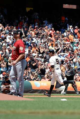 SAN FRANCISCO, CA - JUNE 14:  Brandon Belt #9 of the San Francisco Giants trots around the bases after hitting a two-run home run as pitcher Wandy Rodriguez #51 of the Houston Astros looks on in the fourth inning at AT&T Park on June 14, 2012 in San Francisco, California.  (Photo by Thearon W. Henderson/Getty Images) Photo: Thearon W. Henderson, Getty Images