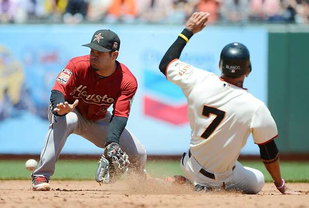 SAN FRANCISCO, CA - JUNE 14:  Gregor Blanco #7 of the San Francisco Giants steals second base beating the throw to Jose Altuve#27 of the Houston Astros in the fifth inning at AT&T Park on June 14, 2012 in San Francisco, California.  (Photo by Thearon W. Henderson/Getty Images) Photo: Thearon W. Henderson, Getty Images